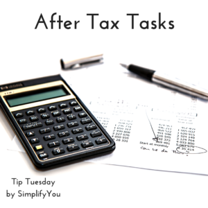 calculator, pen, and tax papers
